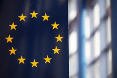 The EU flag; sunrays reflecting Royalty Free Stock Photo