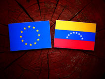 EU. Flag with Venezuelan flag on a tree stump isolated Royalty Free Stock Photography