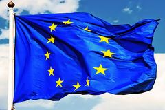 EU flags. Flag of Europe - is a 12 gold five-pointed stars arranged in a circle, like the figures on the clock face. Originally was the flag of the Council of Royalty Free Stock Photography