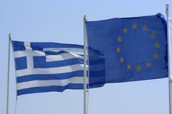 Eu flags. Greek and EU flag against blue sky stock images