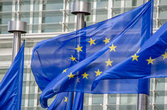 EU flags. In front of European Commission in Brussels Stock Photography
