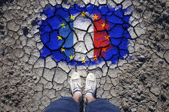 Eu and France flag with man on cracked floor Royalty Free Stock Images