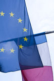 EU and French flag. A European Union flag and a French flag flying together Stock Image