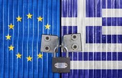 EU and Greece flag on door with padlock royalty free stock photography