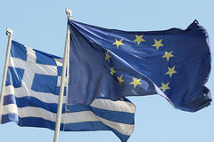 EU and Greek Flag. THESSALONIKI,GREECE - SEPT 4: European Union flag and Greek flag, waving in the wind on September 4, 2012 in Thessaloniki, Greece Stock Photography