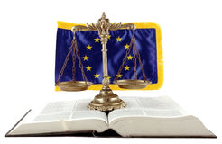 EU Law. Decorative Scales of Justice, book and EU flag on the white background stock photo