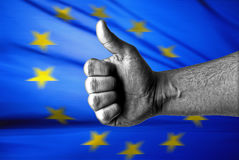 EU likes this. Concept with thumbs up and EU flag Royalty Free Stock Images