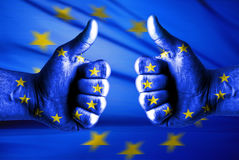 EU likes this. Concept with thumbs up and EU flag Stock Photo