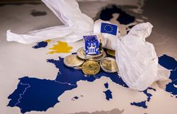 EU map with euro coins and a plastic bag symbolizing european plastic tax regulation. The European Union plans to propose a tax on plastic bags and packaging in Royalty Free Stock Image