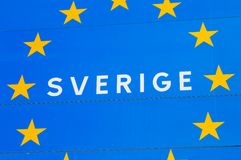 EU member state Sweden. Close up of a road sign at the border to a EU member state Sweden, with the Swedish Sverige for Sweden incircled by golden stars on blue Stock Photo