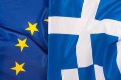 EU- och Grekland flaggor Arkivbild
