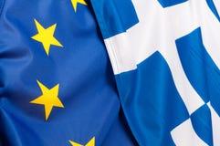 EU- och Grekland flaggor Royaltyfria Bilder