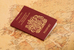 EU Passport on a world map Royalty Free Stock Photo