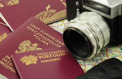 EU passports on a map with key and camera Stock Photography