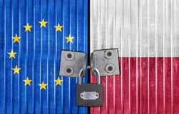 EU and Poland flag on door with padlock. Entrance background Royalty Free Stock Images