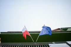 EU and Poland flag waving in the wind.  Royalty Free Stock Images