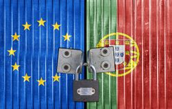 EU and Portugal flag on door with padlock stock photo