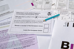 EU Referendum ballot paper. BASINGSTOKE, UK - JUNE 13, 2016: Postal ballot paper and envelopes for the UK Referendum on whether to remain in or leave the Stock Photography