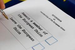 EU Referendum ballot paper, black pen, and passport on the table. Closeup royalty free stock photo