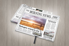 EU refugee crisis breaking news in newspaper on a table Stock Images