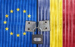 EU and Romania flag on door with padlock. Entrance background Royalty Free Stock Image