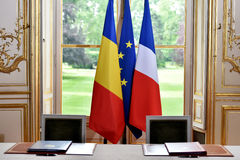 EU and Romania treaty sign. European Union and Romania flags during a treaty sign Royalty Free Stock Photos