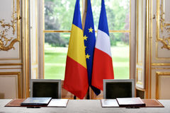 EU and Romania treaty sign. European Union and Romania flags during a treaty sign Royalty Free Stock Images