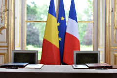 EU and Romania treaty sign. European Union and Romania flags during a treaty sign Stock Images