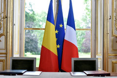 EU and Romania treaty sign. European Union and Romania flags during a treaty sign Stock Photos