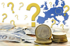 EU's future. Photo compilation of euro coins, torn twenty euro note and fifty euro notes with EU map and falling question marks regarding to the future of Stock Images