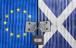EU and Scotland flag on door with padlock. Entrance background royalty free stock photo