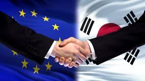 EU and South Korea handshake, international friendship relations flag background. Stock photo stock photos