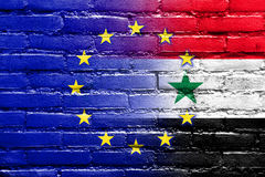 EU and Syria Flag painted on brick wall Royalty Free Stock Image