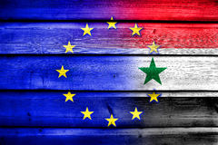 EU and Syria Flag on wood background Stock Photos