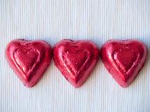Eu te amo - três corações Imagens de Stock