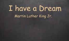 Eu tenho um sonho e um Martin Luther King, júnior escrito no giz na imagem de stock