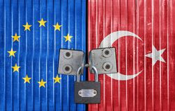 EU and Turkey flag on door with padlock. Entrance background stock photography