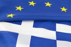 EU und griechische Markierungsfahne Stockfotografie
