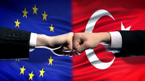 EU vs Turkey conflict, international relations crisis, fists on flag background. Stock photo stock photography