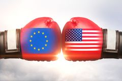 EU vs USA concept. Red boxing gloves with country flags against each other on cloudy sky background. EU vs USA concept. 3D Rendering Stock Photography