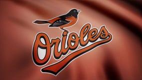 EUA - NEW YORK, o 12 de agosto de 2018: Bandeira de ondulação com logotipo profissional da equipe dos Baltimore Orioles Close-up  ilustração royalty free