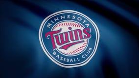 EUA - NEW YORK, o 12 de agosto de 2018: Close-up da bandeira de ondulação com logotipo da equipa de beisebol dos Minnesota Twins  ilustração royalty free