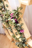 Eucalyptus and pink flowers Stock Photography