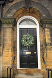Eucalyptus wreath on a black door Royalty Free Stock Image