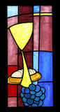 Eucharist. A bright and colorful stained glass window royalty free stock photos