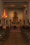 Eucharist Alter and Pews Stock Photography