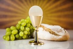Eucharist symbol of bread and wine, chalice and host, First comm. Eucharist, sacrament of communion background royalty free stock images
