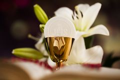 Holy communion a golden chalice with grapes and bread wafers. Eucharist, sacrament of communion background royalty free stock photos