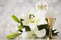 Holy communion a golden chalice with grapes and bread wafers. Eucharist, sacrament of communion background stock image