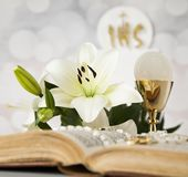 Holy communion a golden chalice with grapes and bread wafers. Eucharist, sacrament of communion background stock photos